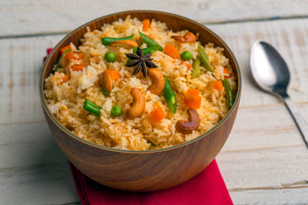 vegetable fried rice vegetable fried rice in a bowl basmati rice stock pictures, royalty-free photos & images