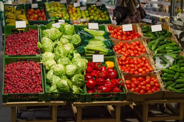 vegetable fruit in supermarket prices food - bazar mercato foto e immagini stock