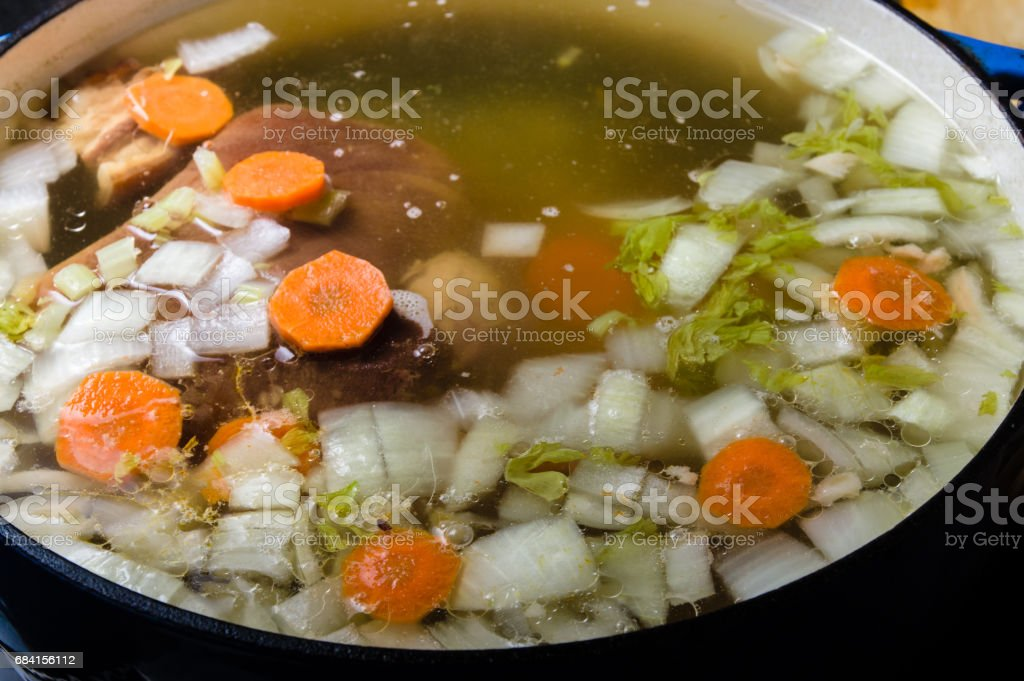 Vegetable ham soup cooking on the stove royaltyfri bildbanksbilder
