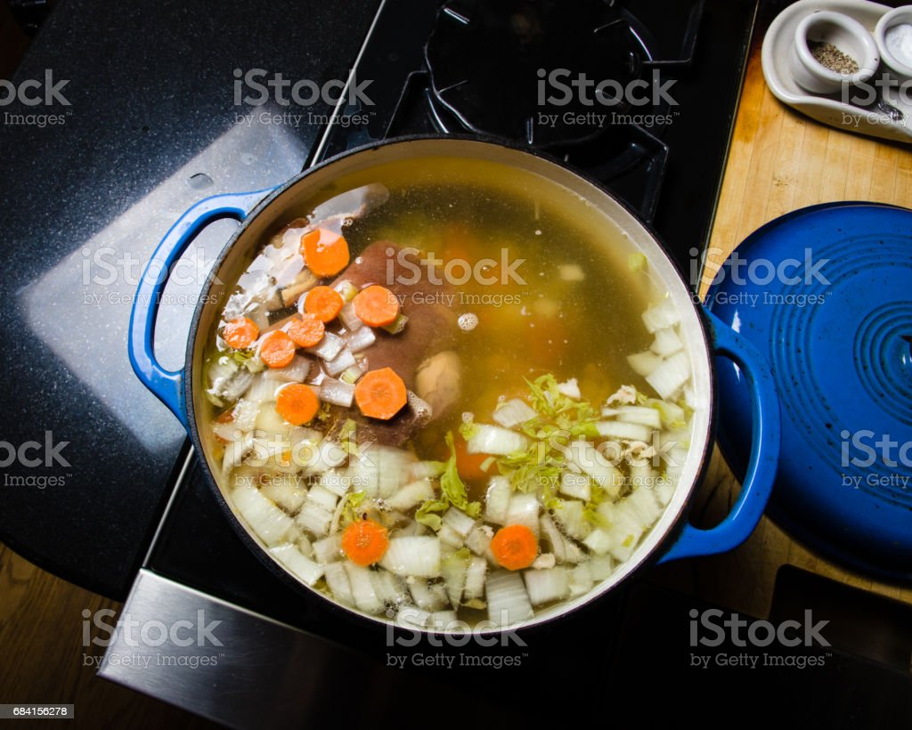 Vegetable ham soup cooking on the stove foto de stock libre de derechos