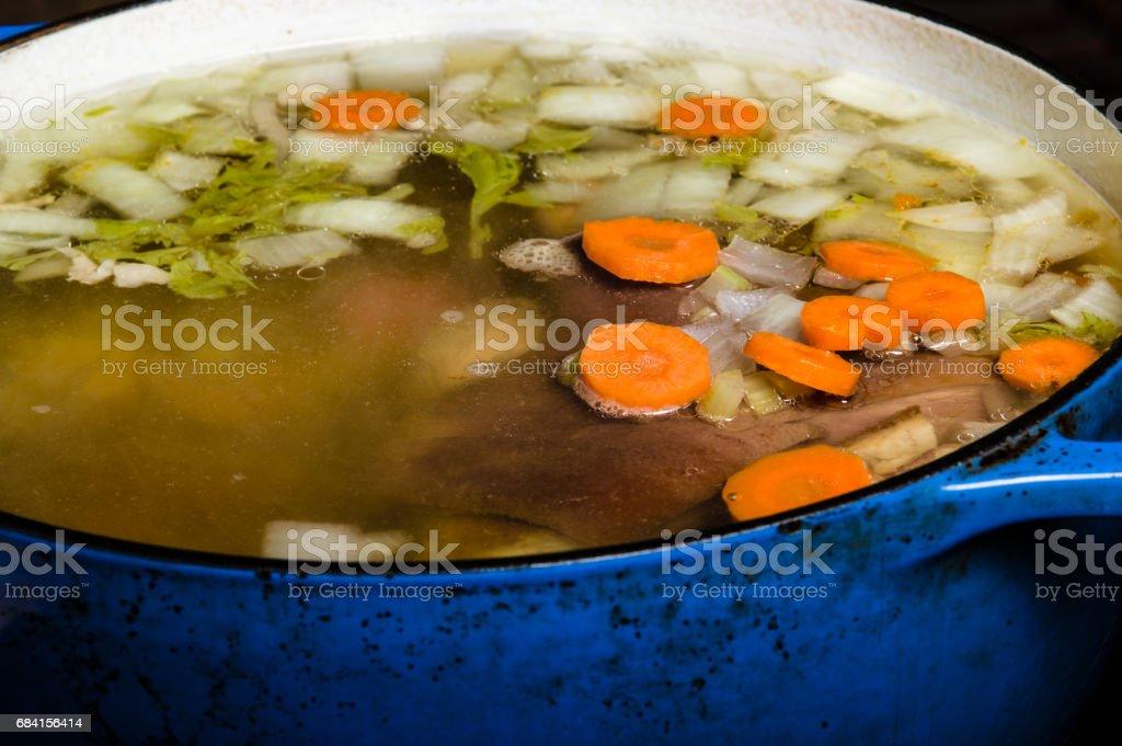 Vegetable ham soup cooking on the stove royaltyfri bildbanksbilder