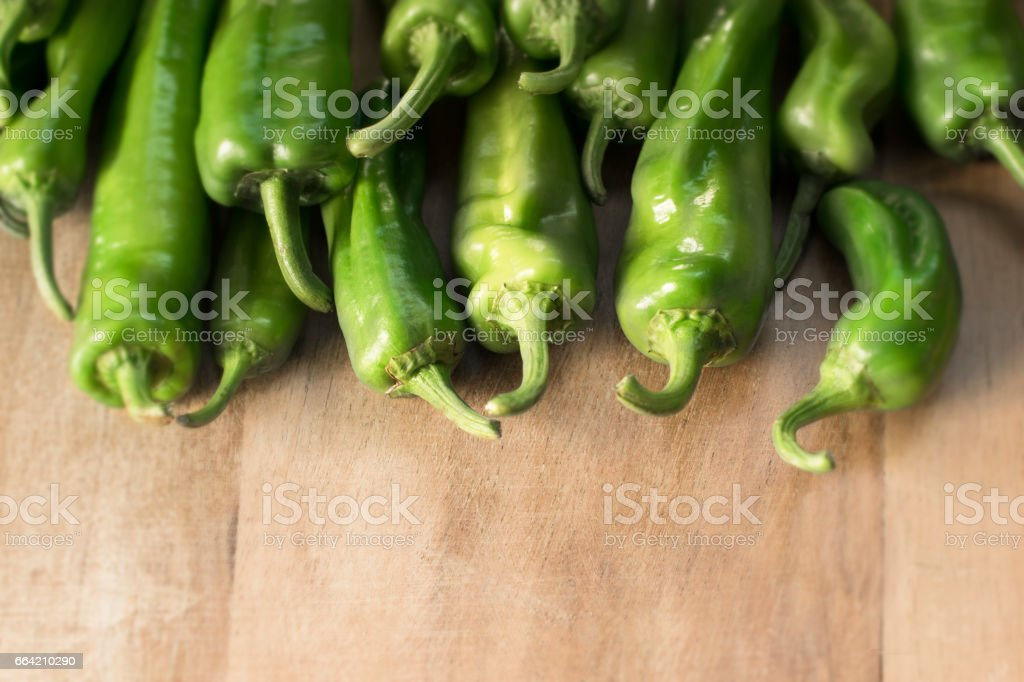 Vegetable ingredients. Green peppers on a wooden background stock photo