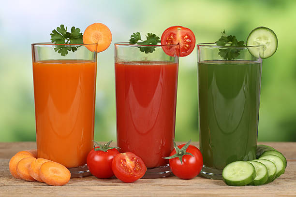 Vegetable juice from carrots, tomatoes and cucumber Fresh vegetable juice from carrots, tomatoes and cucumber vegetable juice stock pictures, royalty-free photos & images