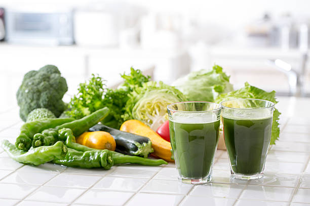 Vegetable juice Shoot green juice of health drink at kitchen at home.Shoot fresh vegetable juice in the kitchen at home. vegetable juice stock pictures, royalty-free photos & images