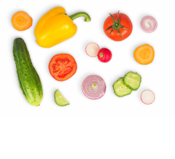 vegetable mix on white isolated background. fresh yellow pepper, chopped tomatoes, onion, round cucumber slice, carrot, radish. the concept of a healthy lifestyle. vegetarian food. - onion juice stock photos and pictures