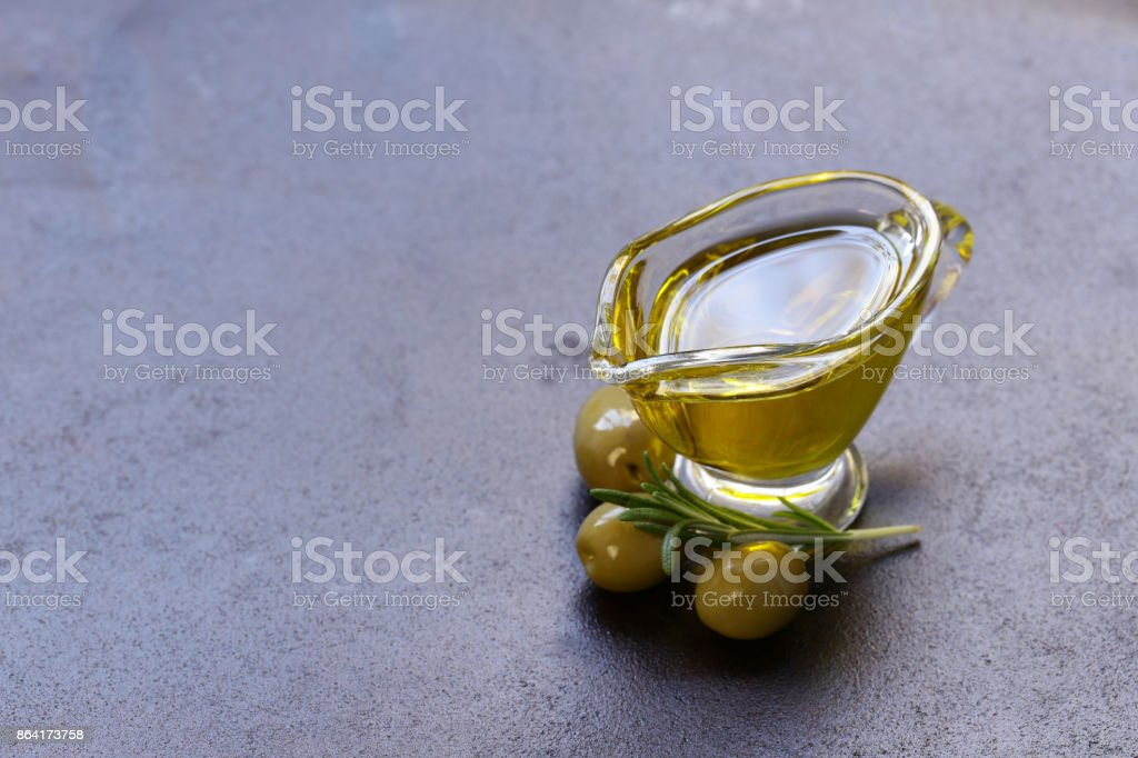 vegetable oil from olives in a glass sauce vessel royalty-free stock photo