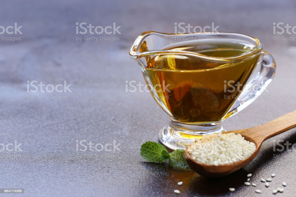 vegetable oil from sesame seeds in a glass sauce vessel royalty-free stock photo