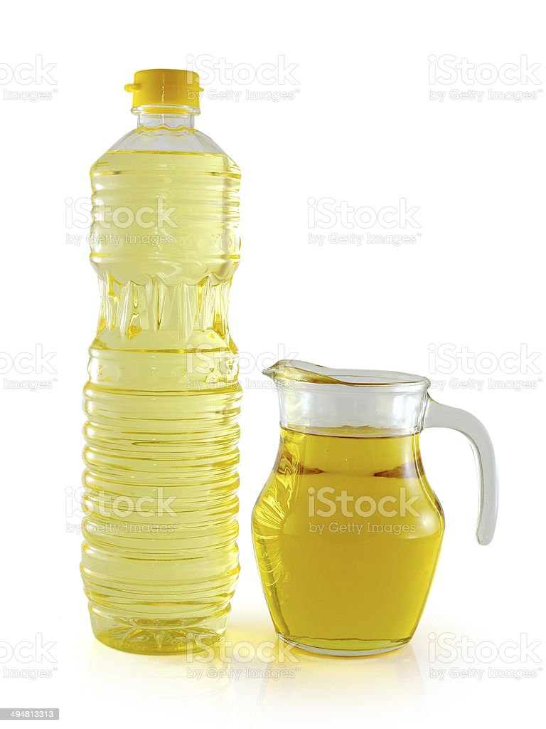 vegetable oil in a plastic bottle and jar stock photo