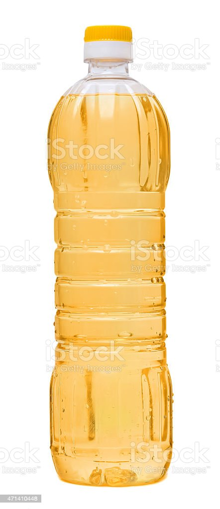 vegetable oil in a plastic bottle isolated on white background stock photo