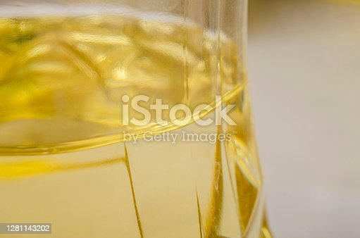 Sunflower oil in a transparent plastic bottle close up