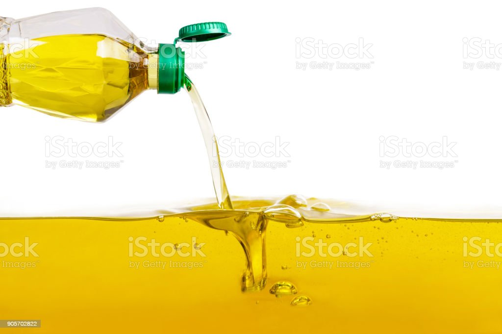 Vegetable oil pouring on vegetable oil background stock photo