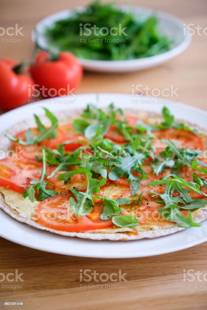 Vegetable omelette wrap for lunch, one of the 5 day veggie meal for the National Vegetarian Week, England - Royalty-free Arugula Stock Photo