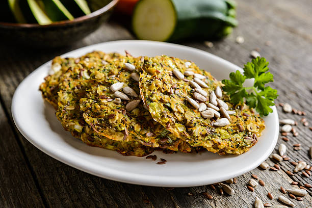 vegetable pancakes with zucchini, carrot, chia, flax seeds and oatmeal - karotten plätzchen stock-fotos und bilder