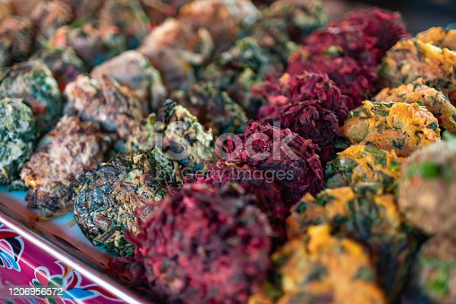 Vegetable patties (tlaltequeadas), made of squash blossom, hibiscus flower, wild greens and amaranth. Prehispanic food at a mexican market