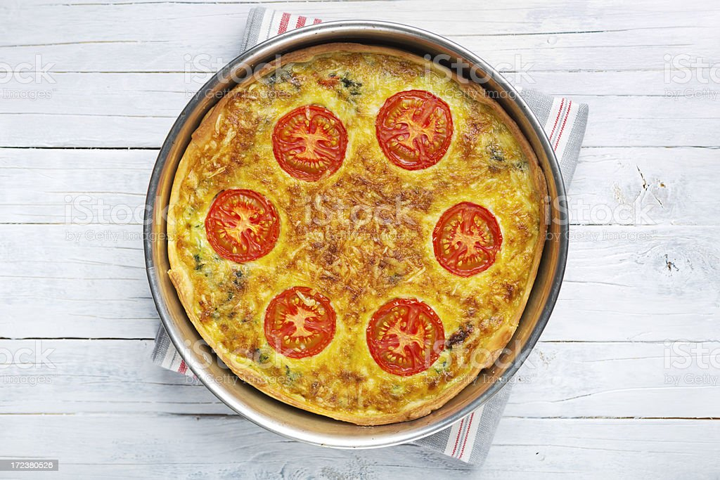 Vegetable quiche on a rustic table, photographed from directly above royalty-free stock photo