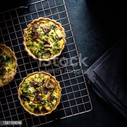 Vegetarian mini-quiches with broccoli, mushrooms, and parmesan cheese.