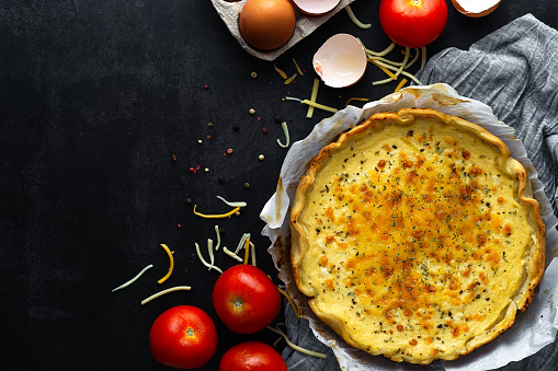Vegetable quiche, tomato, eggs and cheese