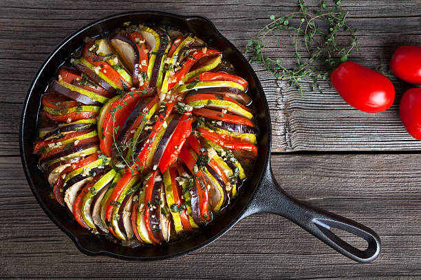 Vegetable ratatouille baked in cast iron frying pan traditional homemade stock photo