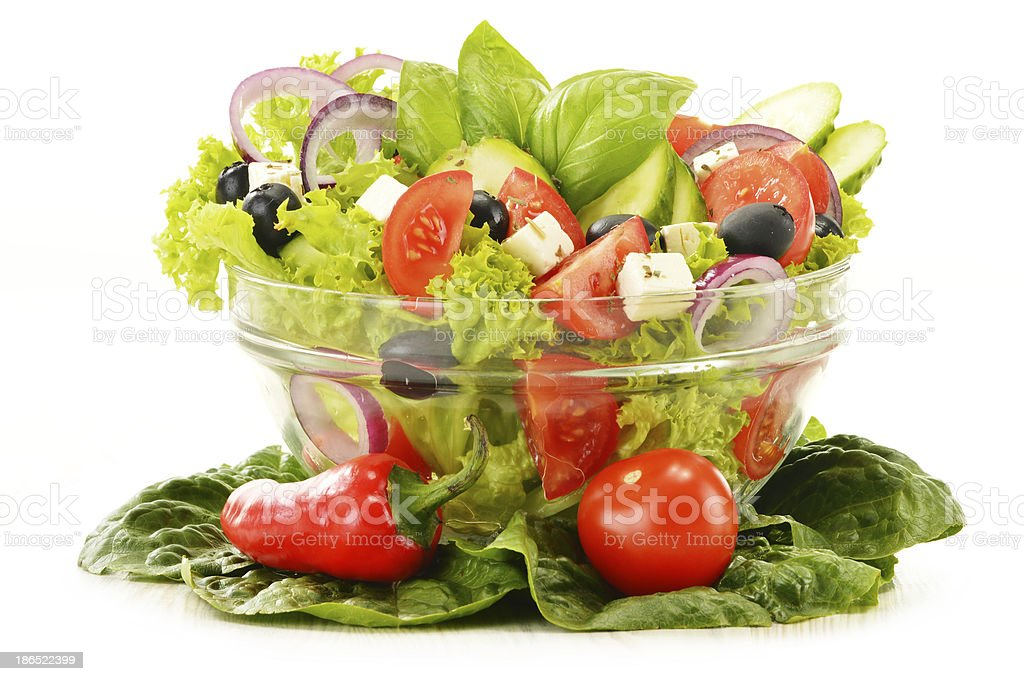 Vegetable salad bowl isolated on white royalty-free stock photo