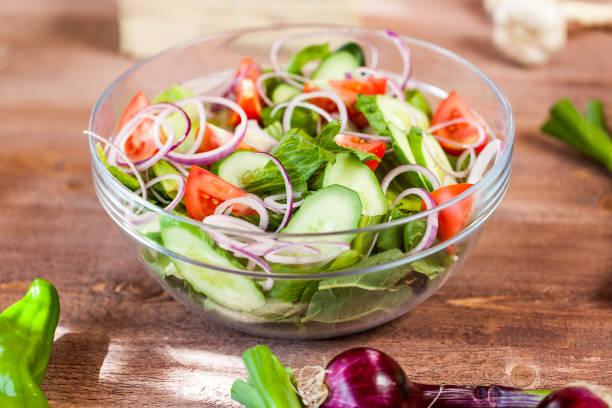 vegetable salad bowl on kitchen table, balanced diet stock photo