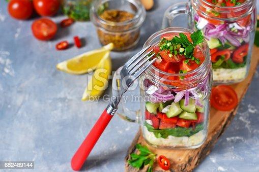 Vegetable Salad In A Glass Jar With Sauce On A Concrete Background - Fotografie stock e altre immagini di Alimentazione sana