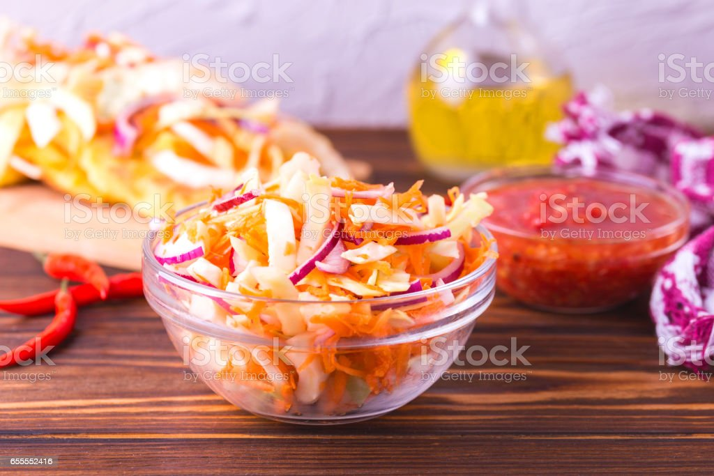 Vegetable salad, Pupuseria, pupusa - corn flour tortillas stock photo