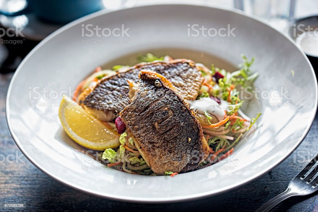 Vegetable salad with beetroot and grilled sea bass stock photo