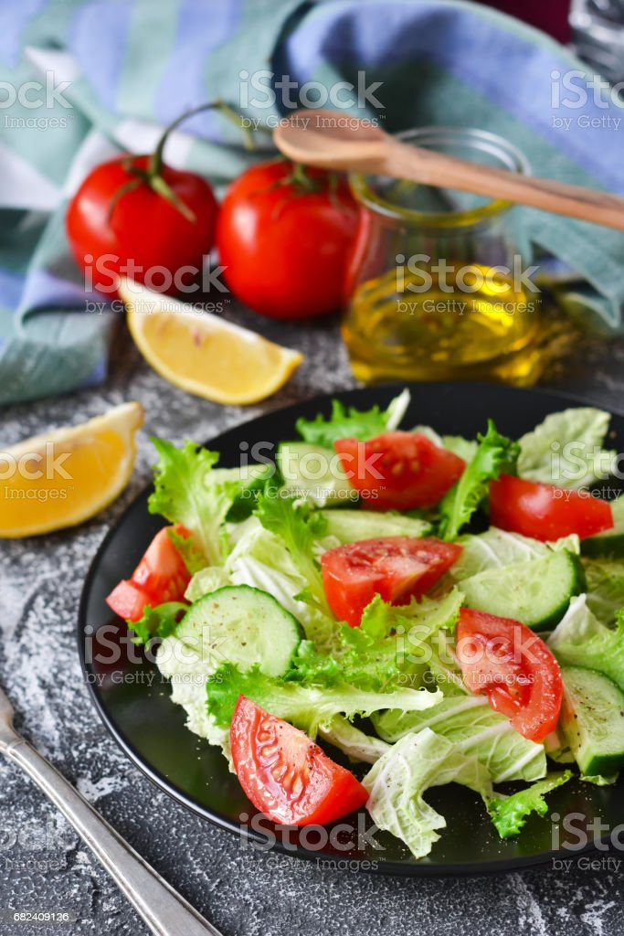 Vegetable salad with cucumber, tomatoes and olive oil on a concrete background royalty-free stock photo