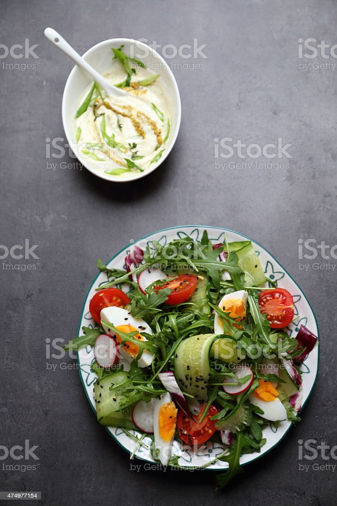 Vegetable salad with homemade dressing stock photo