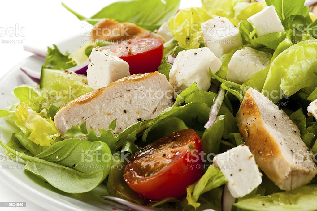 Vegetable salad with roasted chicken breast and feta royalty-free stock photo