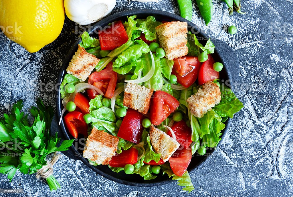 Vegetable salad with romano, tomatoes, peas and croutons royalty-free stock photo