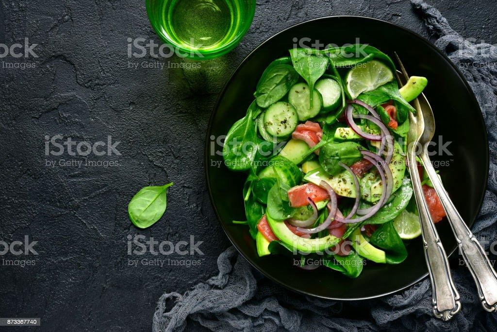 Vegetable salad with salted salmon stock photo