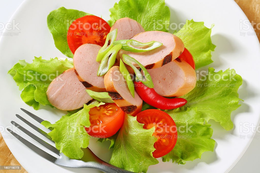 vegetable salad with sausage slices royalty-free stock photo