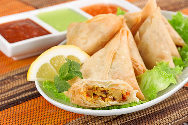 vegetable samosa with indian sauce - samosa stock photos and pictures