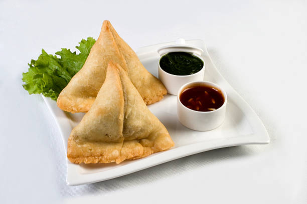 vegetable samosas - indian food - samosa stock photos and pictures