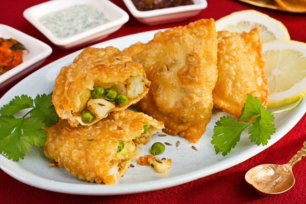 vegetable samosas - samosa stock photos and pictures