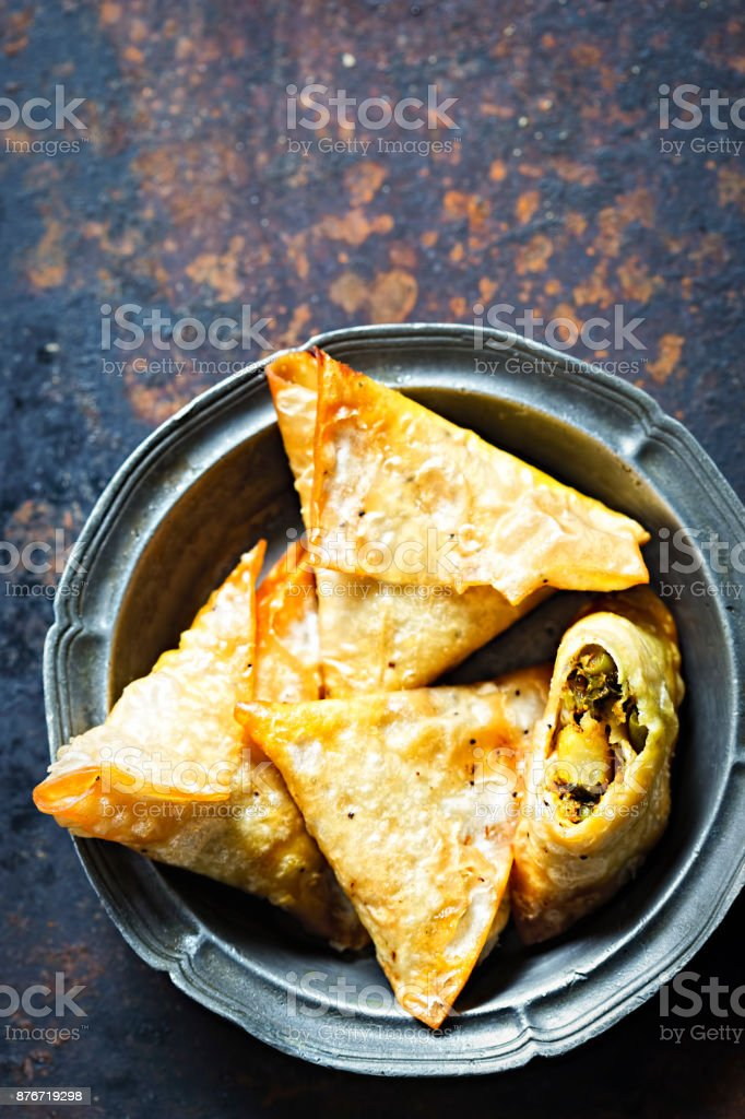 Vegetable samosas with chickpea, spinach and potatoes stock photo