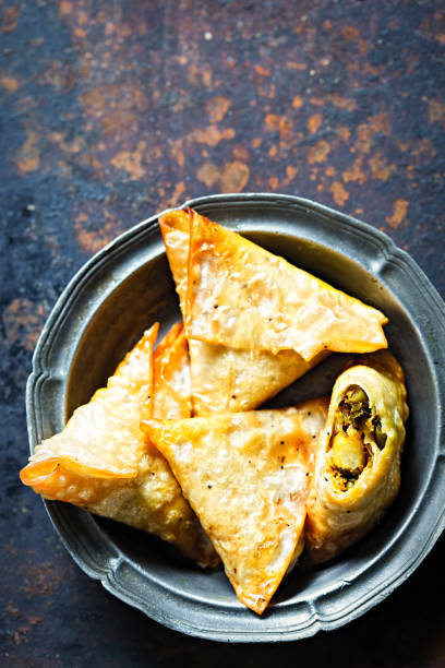 vegetable samosas with chickpea, spinach and potatoes - samosa stock photos and pictures