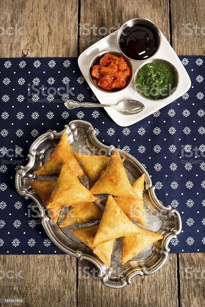 Vegetable Samosas with Dipping Sauces stock photo
