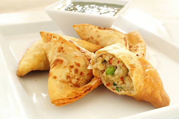 vegetable samosas with llal dip - samosa stock photos and pictures