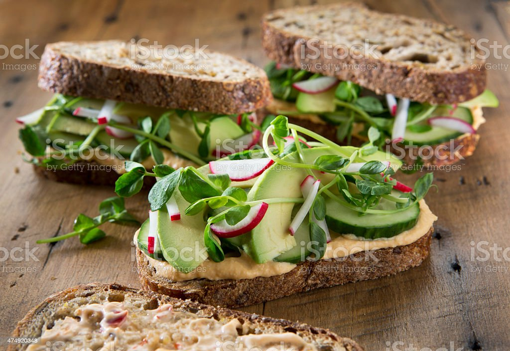 Vegetable Sandwich's on a Rustic Wood Background. stock photo