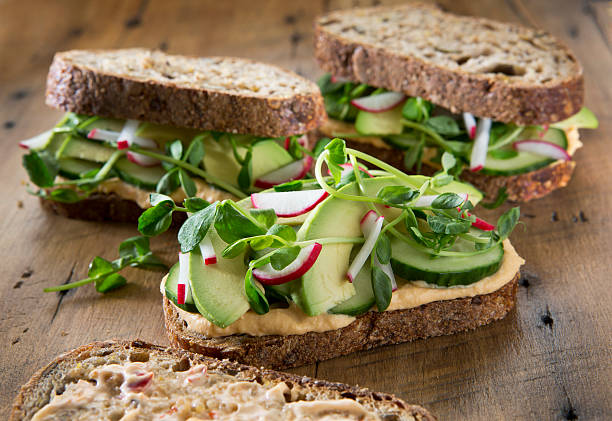 vegetable sandwich's on a rustic wood background. - sandwich stockfoto's en -beelden