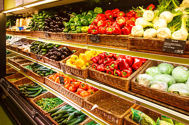 Vegetable section of store in Paris, France Vegetable section in the big city department store, Paris, France produce aisle stock pictures, royalty-free photos & images