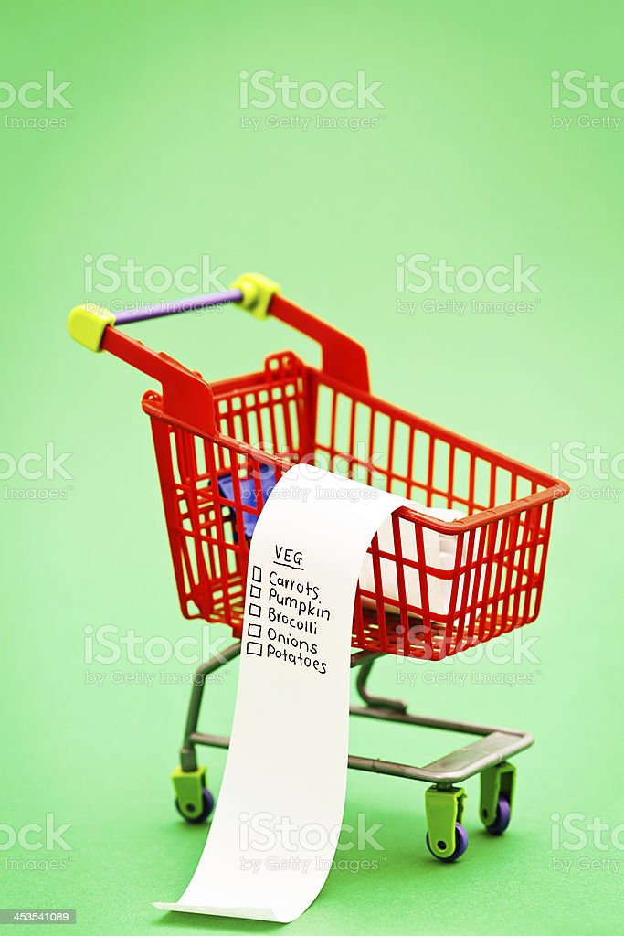 Vegetable shopping list in miniature supermarket trolley: healthy eating choices! royalty-free stock photo