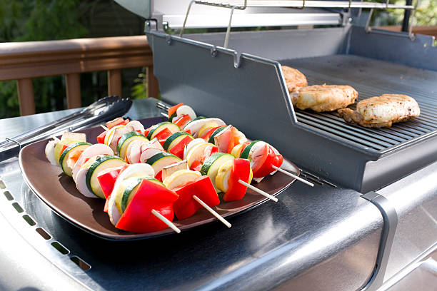 BBQ Vegetable Skewers and Chicken on Outdoor Grill, Copy Space stock photo
