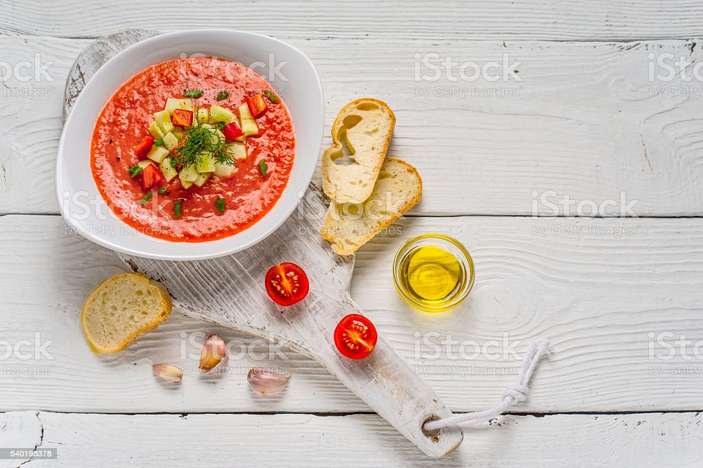 Vegetable soup gazpacho, stand, white bread on the boards stock photo