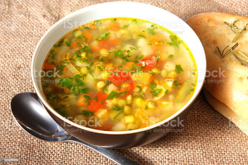 Vegetable soup in white porcelain bowl stock photo