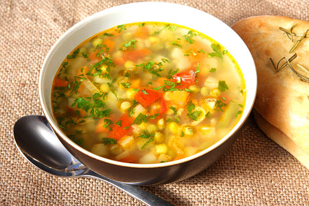 Vegetable soup in white porcelain bowl Vegetable soup vegetable soup stock pictures, royalty-free photos & images