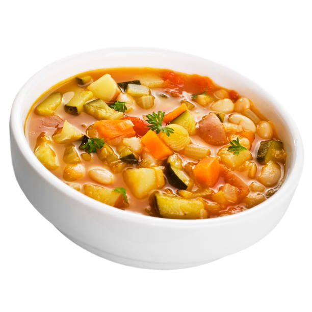 Vegetable Soup on White A bowl of vegetable soup isolated on white. vegetable soup stock pictures, royalty-free photos & images