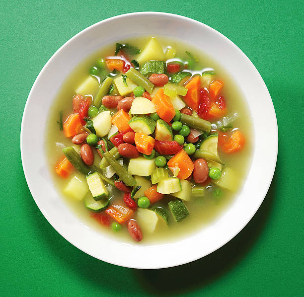 vegetable soup vegetable soup italian minestrone vegetable soup stock pictures, royalty-free photos & images